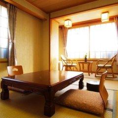 Отель Bergtour Marukita Хакуба комната для гостей