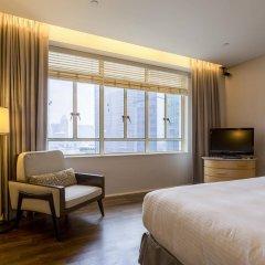 Отель Ascott Raffles Place Singapore удобства в номере