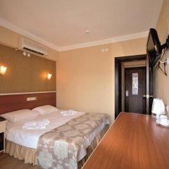 Epic Hotel & Apartments комната для гостей
