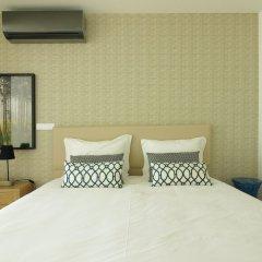 Апартаменты Deluxe Populo Beach Apartments сейф в номере