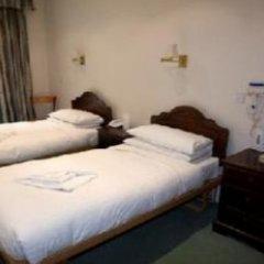 Отель Number 63 Ltd Лондон комната для гостей