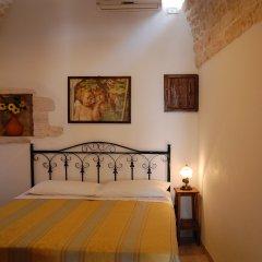 Отель Trulli Holiday Albergo Diffuso Альберобелло комната для гостей