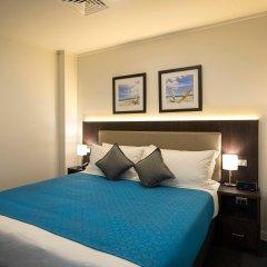 Апартаменты Quest Apartments Suva комната для гостей