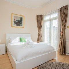 Апартаменты Lovely 2 Bedroom Apartment Near Hyde Park Лондон комната для гостей фото 5