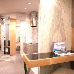 Отель GK Regency Suites удобства в номере