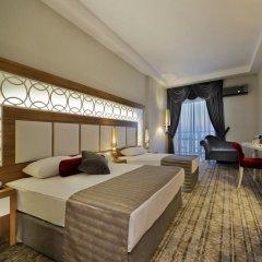 Justiniano Deluxe Resort Турция, Окурджалар - отзывы, цены и фото номеров - забронировать отель Justiniano Deluxe Resort онлайн комната для гостей фото 3