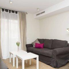 Апартаменты Paralelo Apartments комната для гостей фото 3