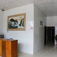 Отель Huaqiao Tourism интерьер отеля