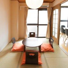 Отель Condominium Tsudoi Fukuoka Хаката комната для гостей