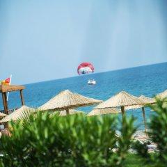 Отель Flora Garden Beach Club - Adults Only пляж