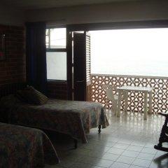 Отель ROSITA Пуэрто-Вальярта комната для гостей