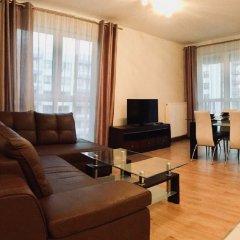 Апартаменты Warsaw Inside Apartments комната для гостей