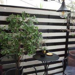 Апартаменты Exclusive Design Studio with Yard Афины балкон