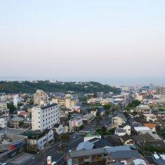 Отель Sansuikan Япония, Беппу - отзывы, цены и фото номеров - забронировать отель Sansuikan онлайн балкон