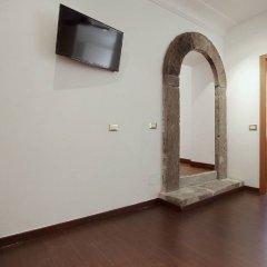 Отель Central Rome Suites удобства в номере