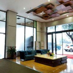 Yijia Holiday Hotel интерьер отеля