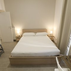 Апартаменты Santi Quattro Apartment & Rooms - Colosseo комната для гостей фото 4