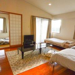 Отель Resort Mansion SeaZone Центр Окинавы комната для гостей фото 4
