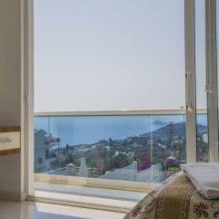 Villa Motion 2 by Akdenizvillam Турция, Калкан - отзывы, цены и фото номеров - забронировать отель Villa Motion 2 by Akdenizvillam онлайн балкон