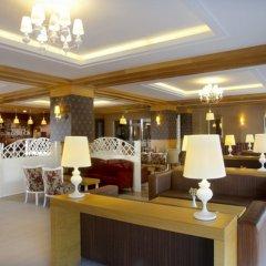 Kirman Arycanda De Luxe Турция, Окурджалар - отзывы, цены и фото номеров - забронировать отель Kirman Arycanda De Luxe - All Inclusive онлайн интерьер отеля