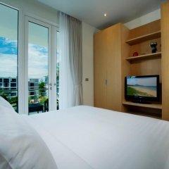 Отель Splash Beach Resort by Langham Hospitality Group комната для гостей фото 2