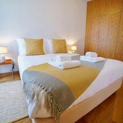 Апартаменты Chiado Apartments Лиссабон комната для гостей фото 2