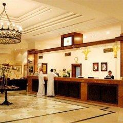 Отель Holiday International Sharjah ОАЭ, Шарджа - 5 отзывов об отеле, цены и фото номеров - забронировать отель Holiday International Sharjah онлайн интерьер отеля фото 3