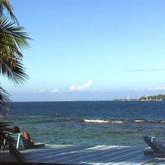 Отель Les Tipaniers Iti Bungalows пляж фото 2