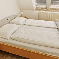 Отель CheckVienna - Apartment Rentals Vienna Австрия, Вена - 11 отзывов об отеле, цены и фото номеров - забронировать отель CheckVienna - Apartment Rentals Vienna онлайн комната для гостей фото 2