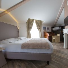 Отель Al Campanile Aparthotel And Suite Бавено комната для гостей