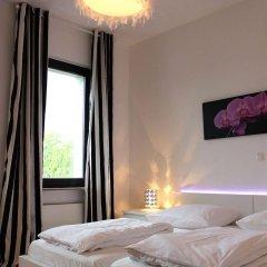 Отель A-Partment Basic Германия, Кёльн - отзывы, цены и фото номеров - забронировать отель A-Partment Basic онлайн комната для гостей фото 4