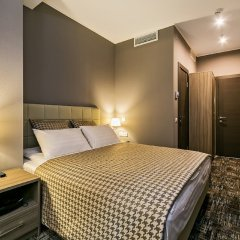 Мини-Отель Панорама Сити комната для гостей
