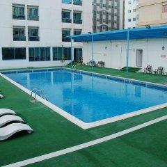 Отель Al Bustan Hotel Flats ОАЭ, Шарджа - отзывы, цены и фото номеров - забронировать отель Al Bustan Hotel Flats онлайн бассейн фото 2