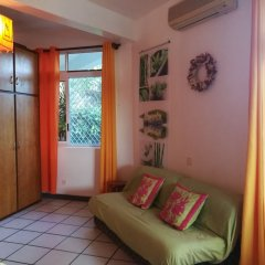 Отель Condo Ora Airport Фааа комната для гостей фото 5