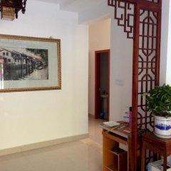 Отель Zhouzhuang Wangjiangting Hostel Китай, Сучжоу - отзывы, цены и фото номеров - забронировать отель Zhouzhuang Wangjiangting Hostel онлайн интерьер отеля