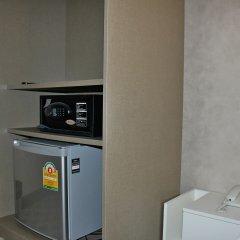 Отель Everest Boutique Бангкок сейф в номере