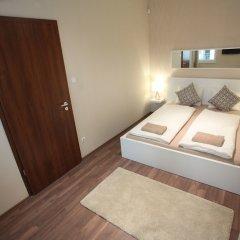 Апартаменты Dfive Apartments - Bland удобства в номере