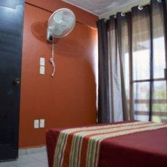 Отель Isabel Suites Zihuatanejo комната для гостей фото 4