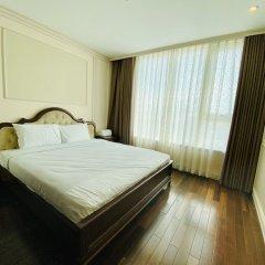 Отель M Suites by S Home Хошимин комната для гостей