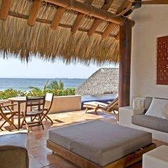 Отель Las Palmas Beachfront Villas Мексика, Коакоюл - отзывы, цены и фото номеров - забронировать отель Las Palmas Beachfront Villas онлайн комната для гостей