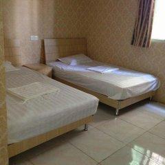 Отель Xiamen Yiqing Apartment Китай, Сямынь - отзывы, цены и фото номеров - забронировать отель Xiamen Yiqing Apartment онлайн комната для гостей фото 3