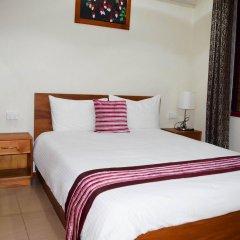 Апартаменты Al-Minhaj Service Apartments комната для гостей