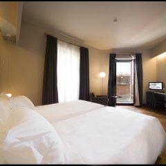 Отель NH Torino Santo Stefano Италия, Турин - 1 отзыв об отеле, цены и фото номеров - забронировать отель NH Torino Santo Stefano онлайн комната для гостей