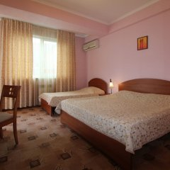 Гостиница Страна магнолий комната для гостей фото 12