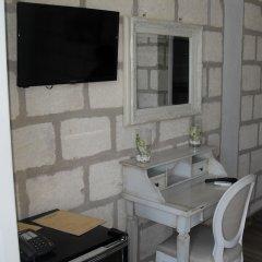 Отель CapoSperone Resort Пальми удобства в номере фото 2