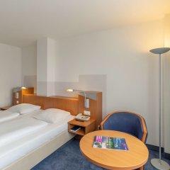 Отель Ramada by Wyndham Hannover Германия, Ганновер - отзывы, цены и фото номеров - забронировать отель Ramada by Wyndham Hannover онлайн комната для гостей фото 6