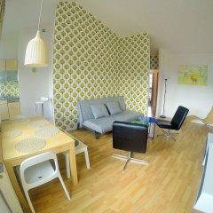 Апартаменты Victus Apartments I комната для гостей