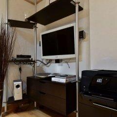 Отель Home Sorbara сейф в номере