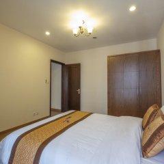 Апартаменты Bayhomes Times City Serviced Apartment комната для гостей фото 3