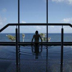 Отель Vidamar Resort Madeira - Half Board Only Португалия, Фуншал - отзывы, цены и фото номеров - забронировать отель Vidamar Resort Madeira - Half Board Only онлайн бассейн фото 2